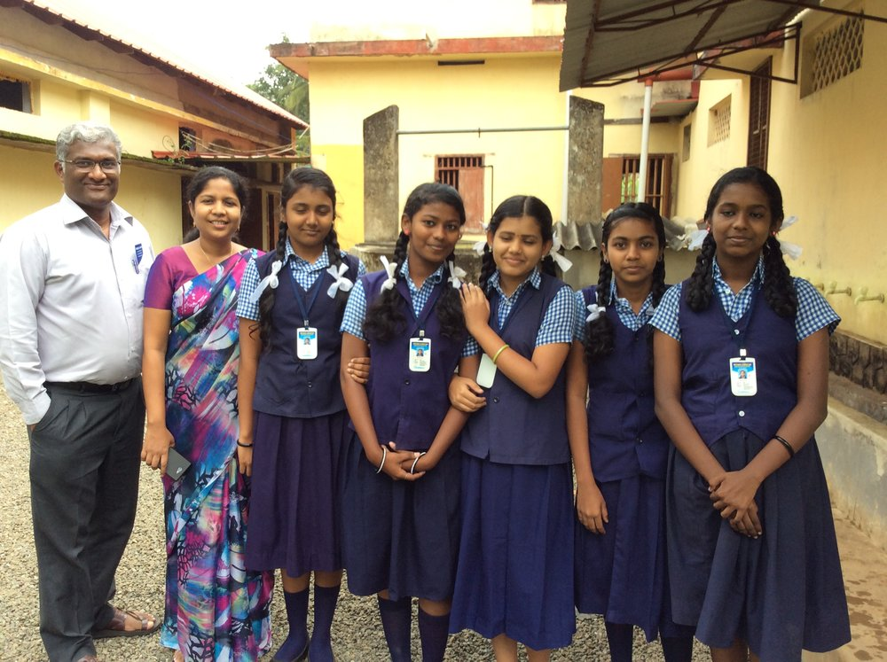 Shibu and Julie with students of Day School