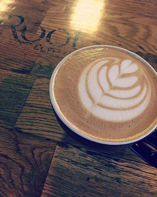 We love getting customer photos! This one is from Carolyn. Tag #rootscoffeehouse for a chance to be featured in our feed. #fridays #feature #latteart #tulip #craftcoffee #tag #espresso #latte