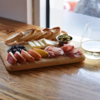 Harvest Board  aged white cheddar, prosciutto, apples, pesto, crostini, & dried cranberries (try our GF version as well!)