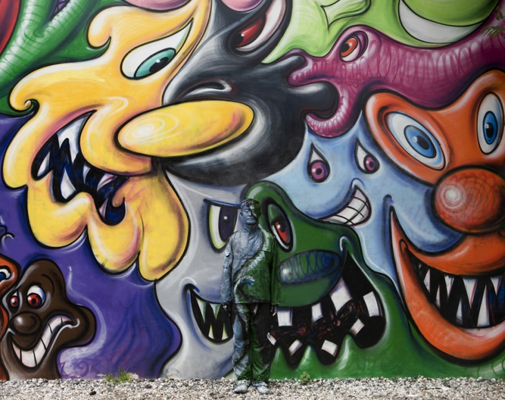 Liu Bolin (Shandong)   Hiding in New York No. 2 Kenny Scharf Mural  2011   Photograph