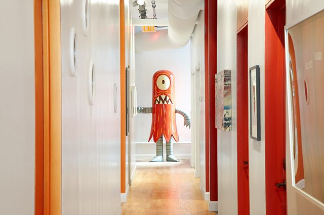 Meet the Art - this is our Super Giant Helper created by Tim Biskup. He guards the hallways of Meet in SoHo!