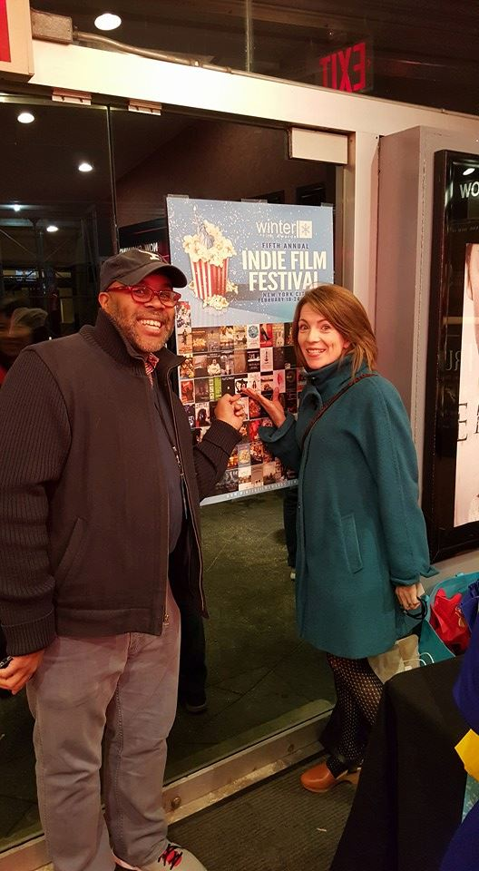 Before the screening. We were excited to find our logo on the festival poster!