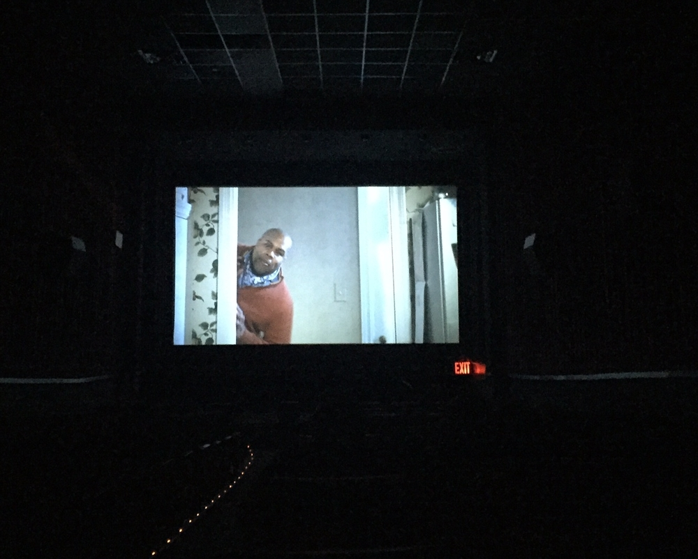 Kevin on the big screen! (see the floor lights and exit sign? we're LEGIT in a theater!)
