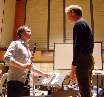 As clarinet soloist, Brenden Guy works with Marin Symphony conductor Alasdair Neale in rehearsal with the Curious Flights Symphony Orchestra.