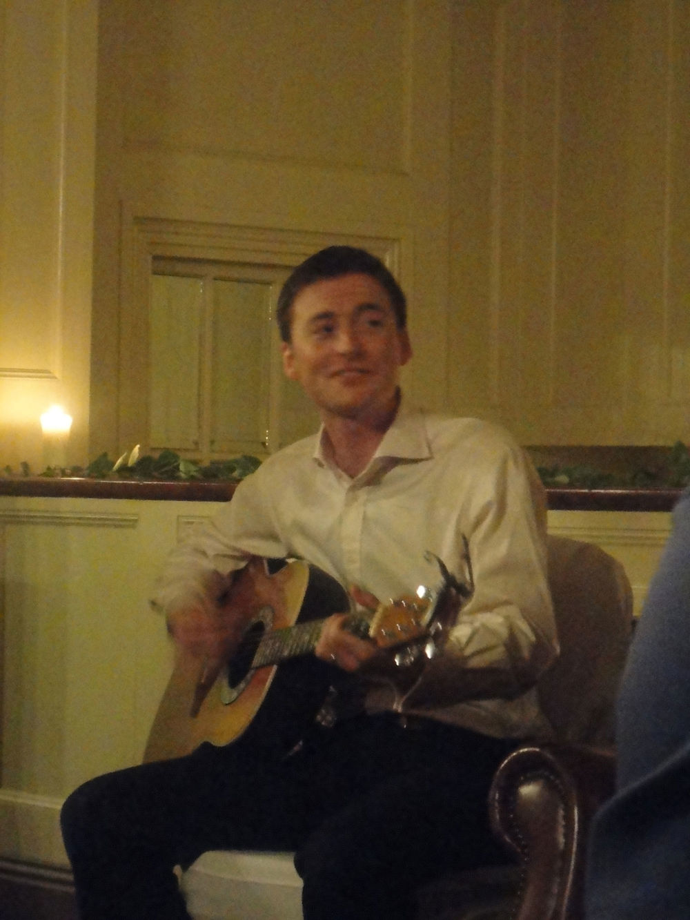 Blurry shot of my groom entertaining the late crowd :)