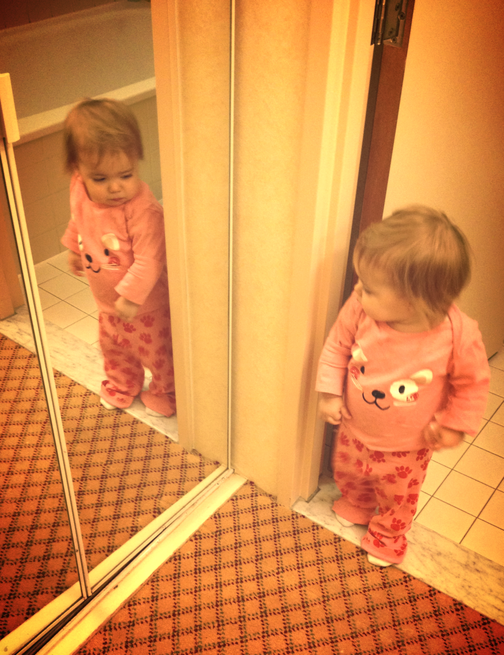 Bug trying to sneak up on her reflection in the hotel mirror...!