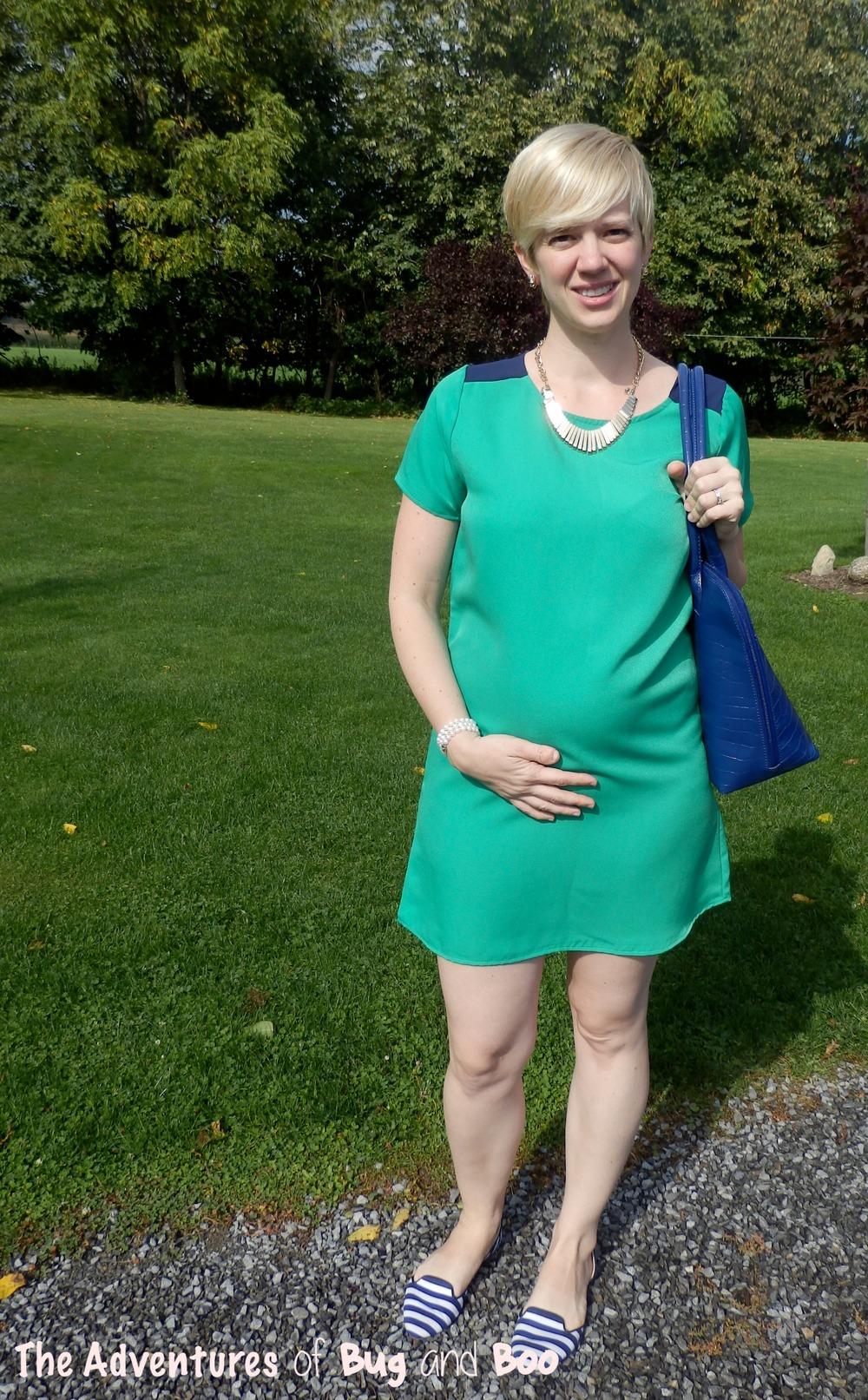 Color blocked shift dress, starburst gold necklace, blue croc print handbag