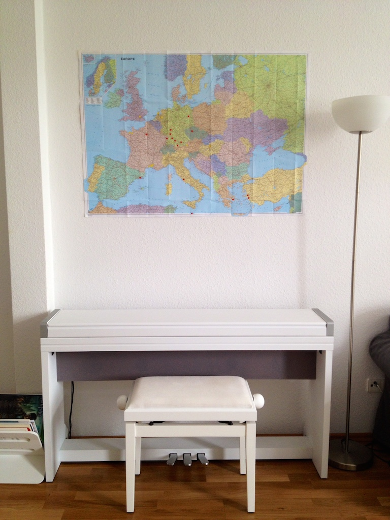 The places we've been on a fold-out map above our piano.