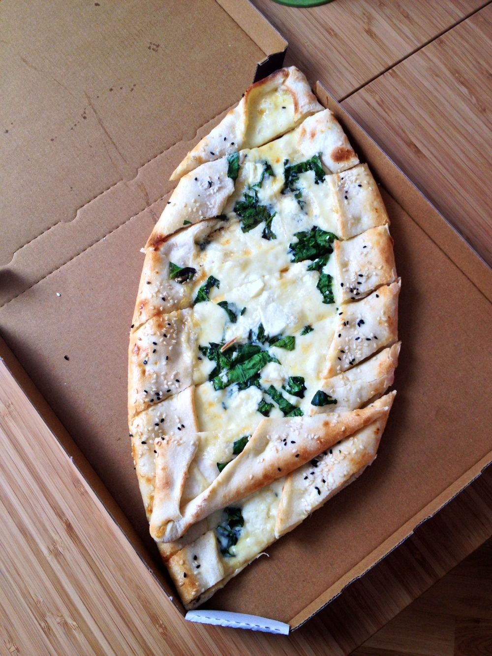 Pide with spinach, cheese, and egg.