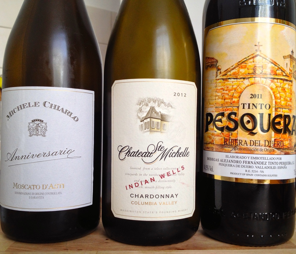 (From Left) Michele Chiarlo Anniversario Moscato D'Asti 2012; Chateau Ste. Michelle Indian Wells Chardonnay 2012; Bodegas Alejandro Fernández Tinto Pesquera 2011