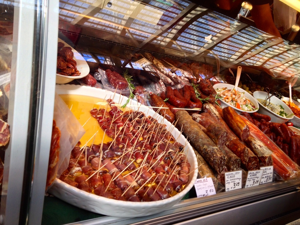 Fresh chorizo and prosciutto-wrapped dates, apricots, and figs at El Mercado Español