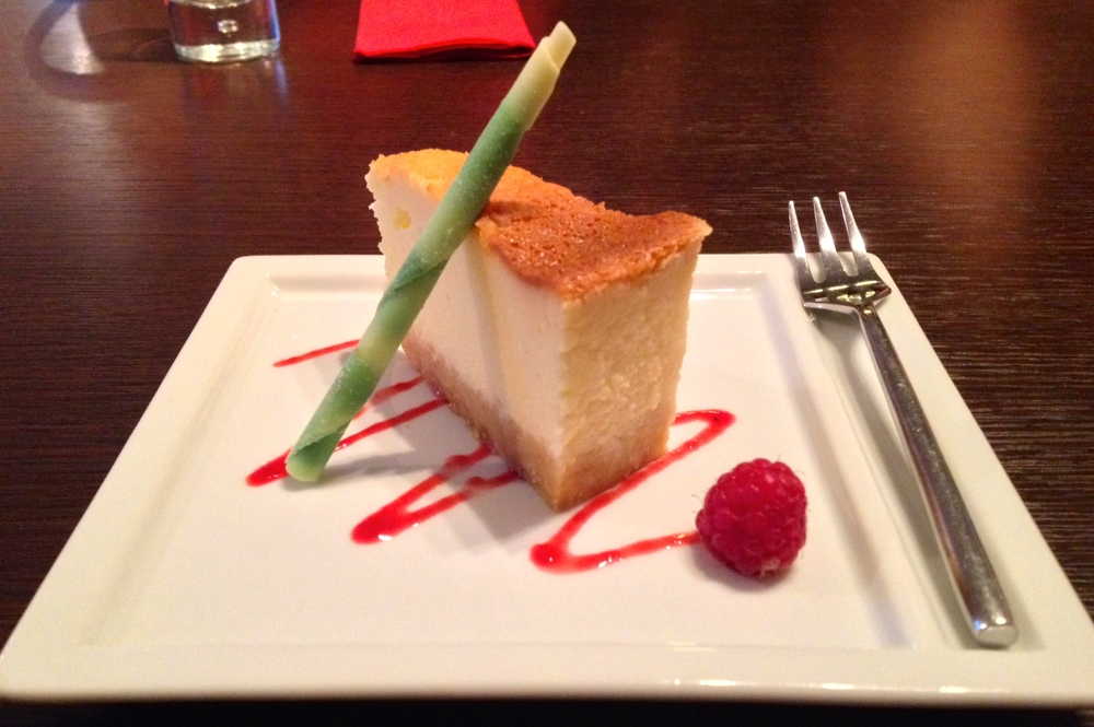 Ginger cheesecake with a green tea-white chocolate stick