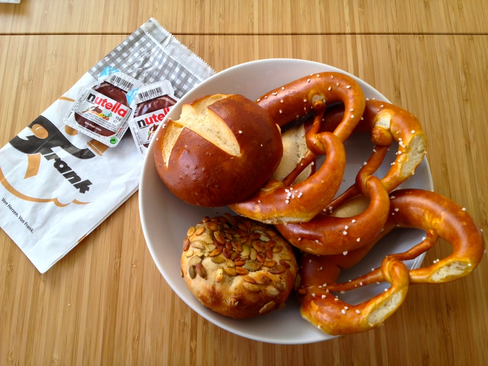 A  Laugenbrötchen  at the top left, three pretzels, and a  Kürbiskern Brötchen  to the bottom left (click for a larger image)