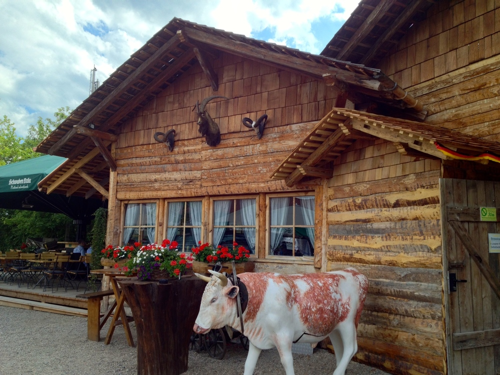 "Lovely ""traditional"" huts with a fake cow"