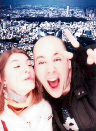 Fun in a photo booth with Tokyo in the background