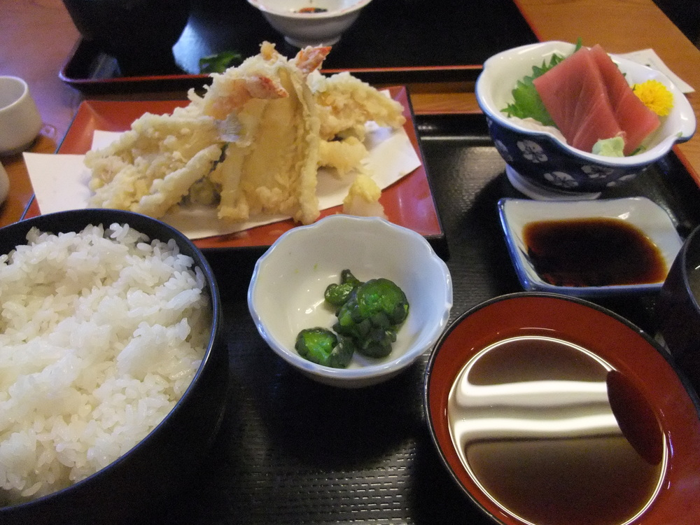 A  tempura  meal complete with Japanese pickles, rice, and sashimi