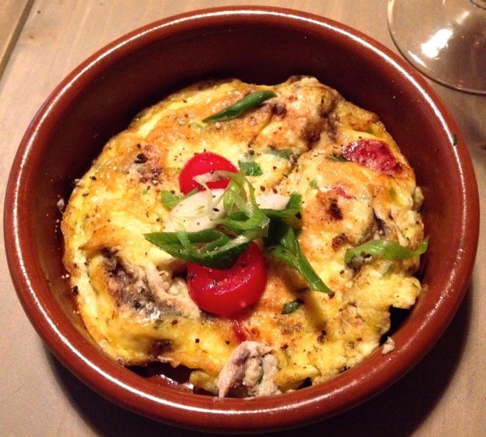 San José omelette with anchovies, spring onions, tomatoes, and herbs