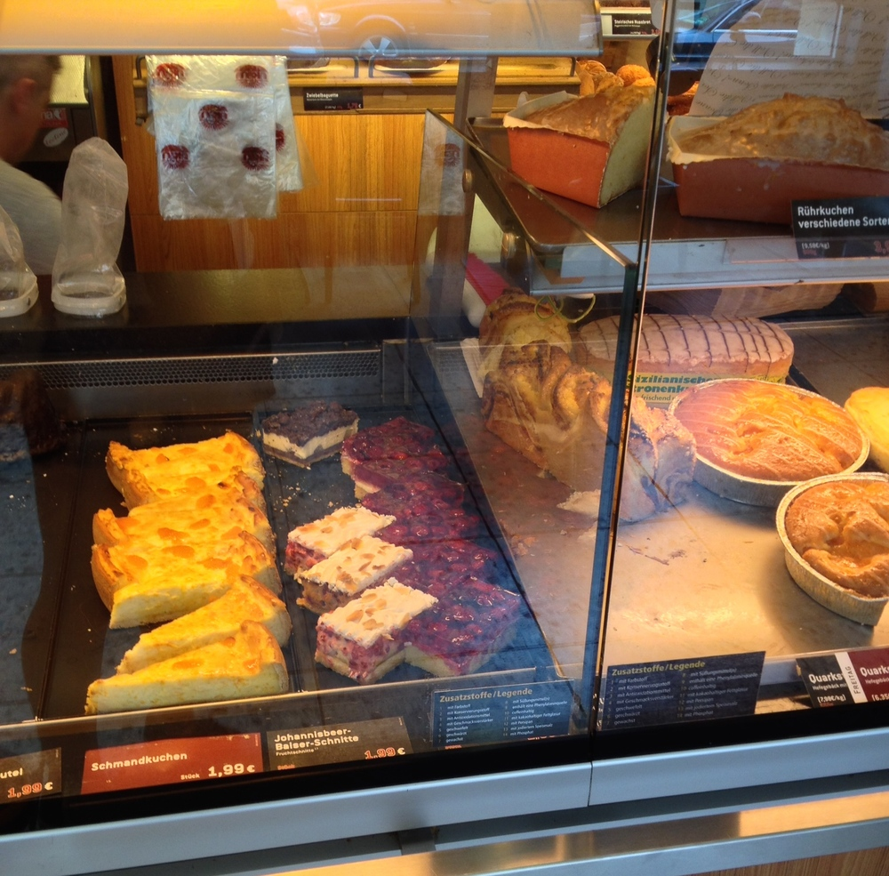 Slices of cake in a bakery window