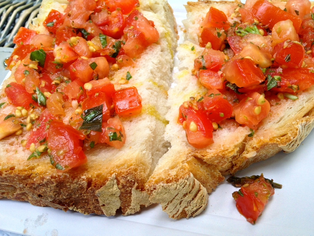 Fresh bruschetta on top of a delicious crusty, soft Italian bread