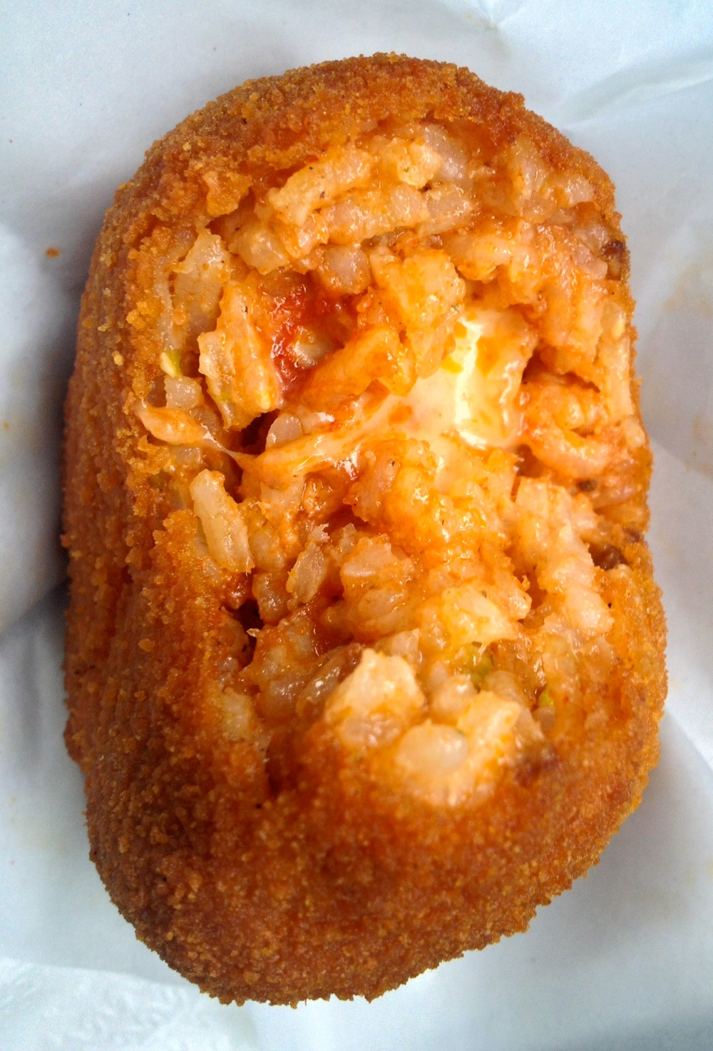Fried arancini (Italian cheese and meat rice ball)