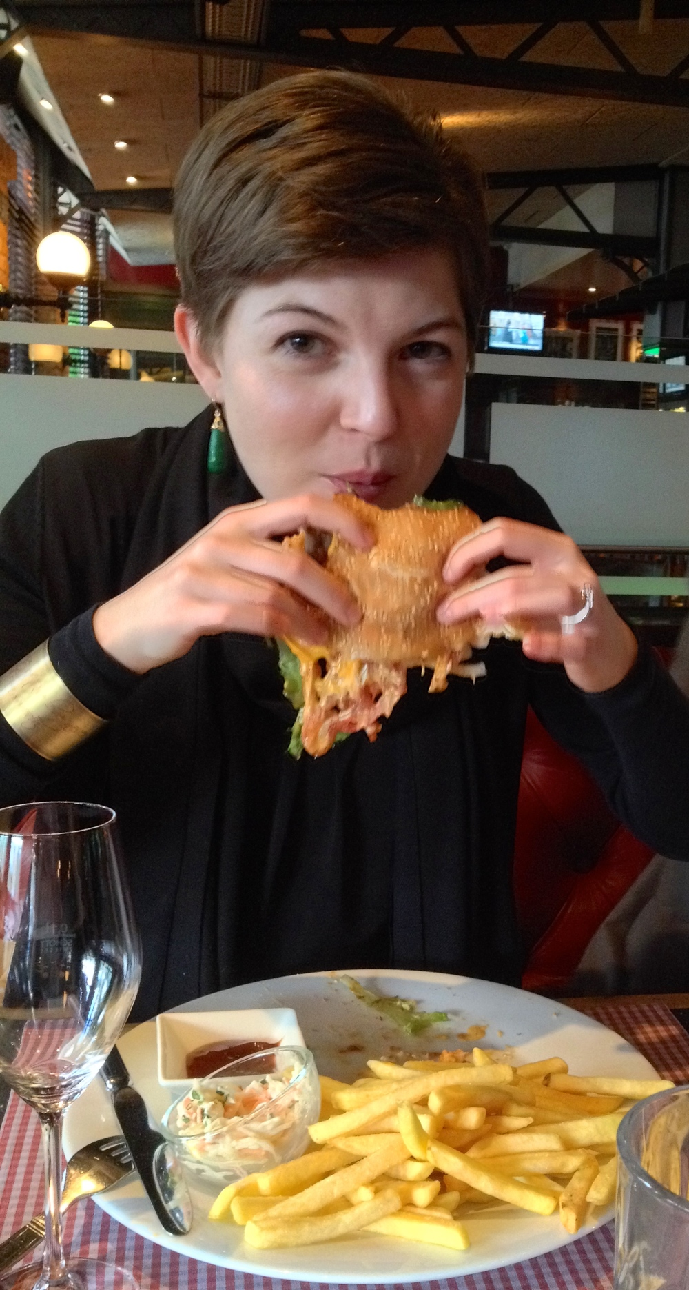 Me enjoying a very messy burger one evening after work
