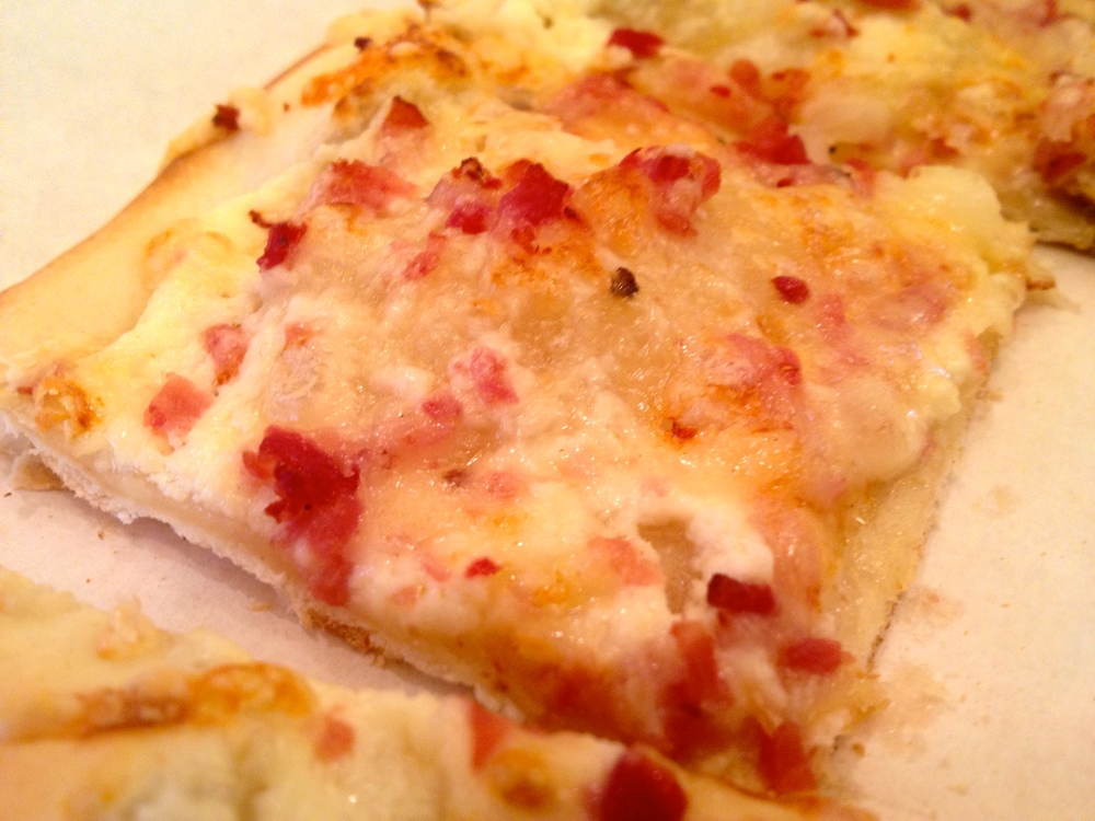 "Flammkuchen -- Alsatian ""pizza"" with bacon and onions on a thin crust"