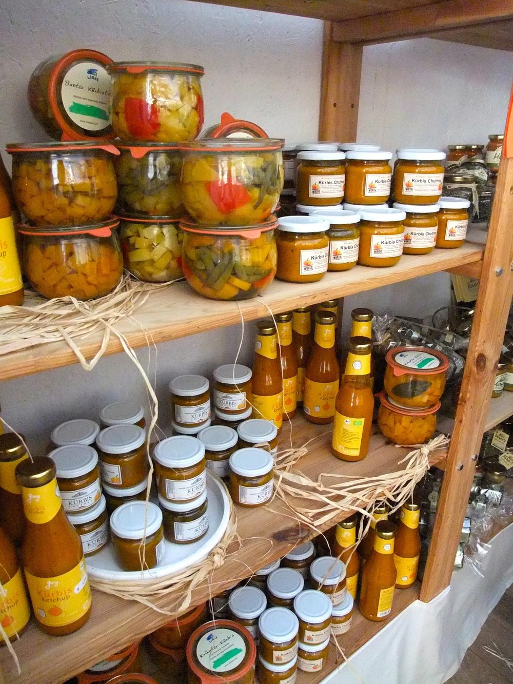 Jars of pumpkin curry, ketchup, and pumpkin