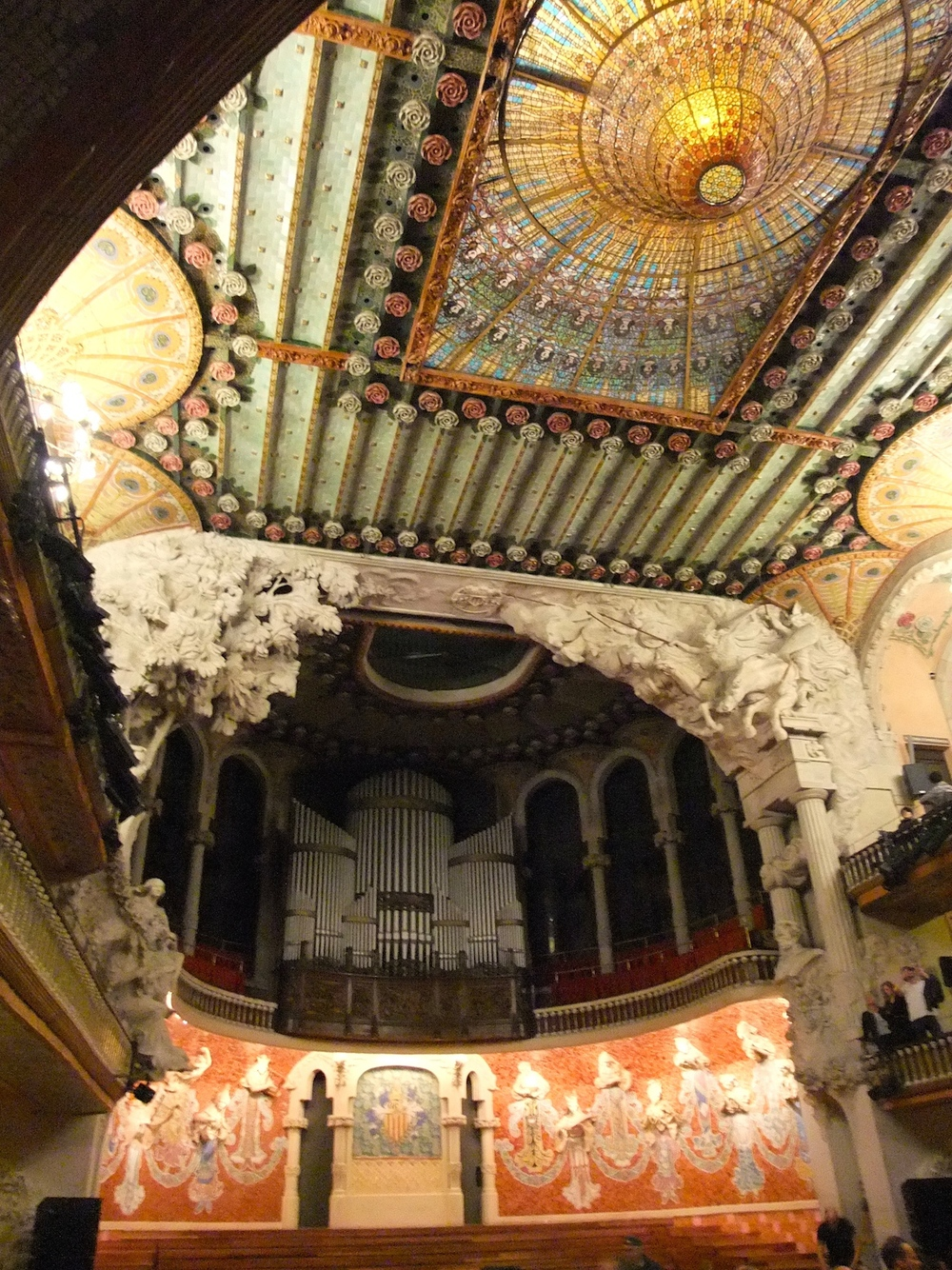The stunning ceiling inside the Palau de la Música