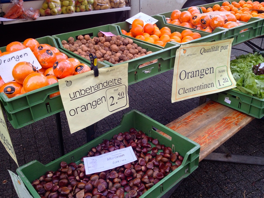 Oranges, walnuts, and chestnuts for sale at the market