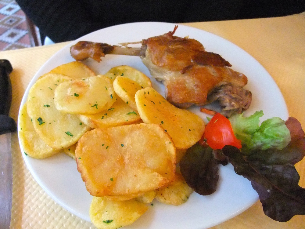 Duck  confit  with pan-fried potatoes at   Restaurant Le Royal Vendôme