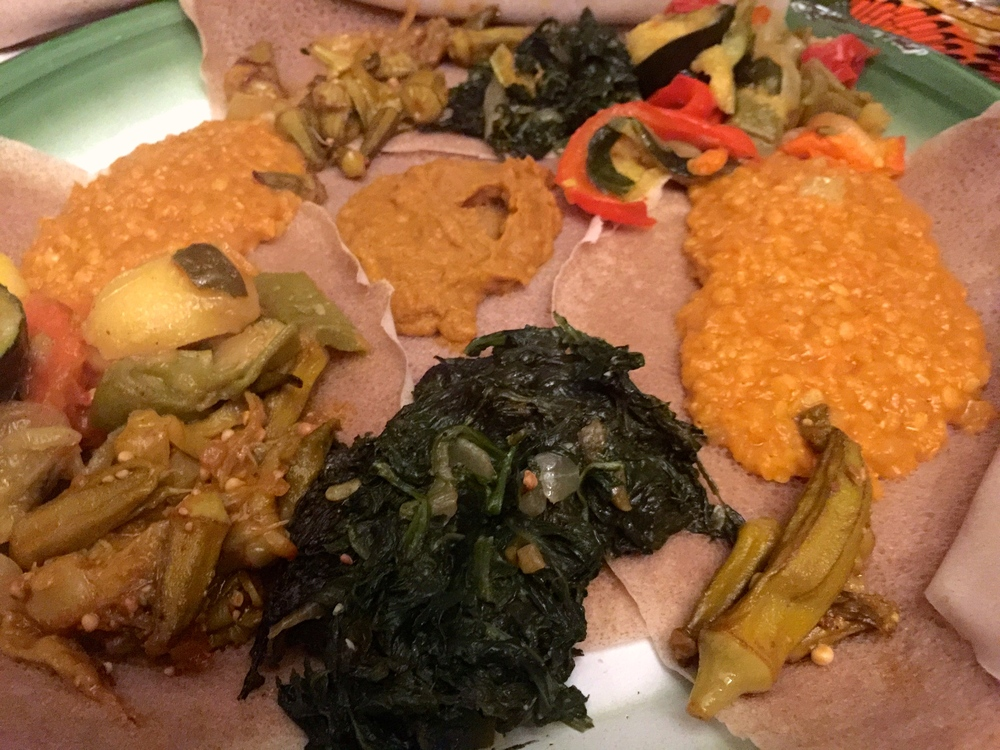 Vegetable platter with okra, lentils, spinach, and potatoes