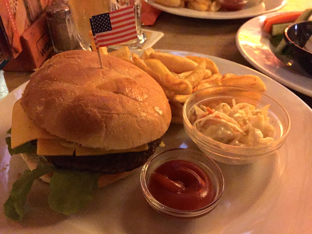 My burger with an American flag sticking out of it to tell you that it's American