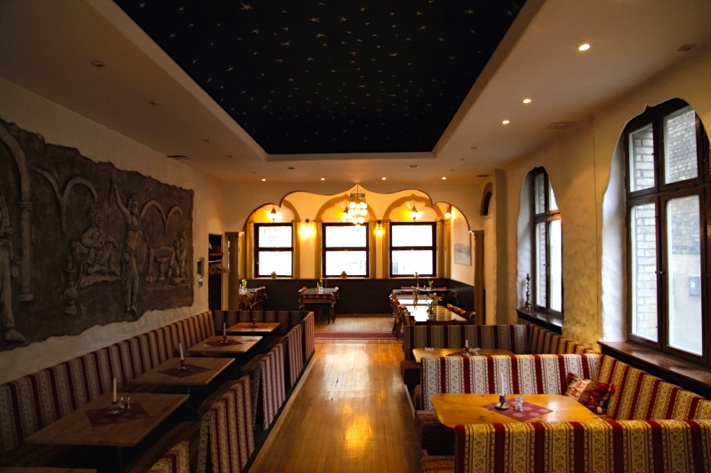 An inside shot of the restaurant from Taverna Yol's website with a view of the cool floor-height couches