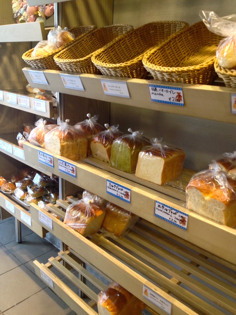 Shelves lined with Japanese-style bread