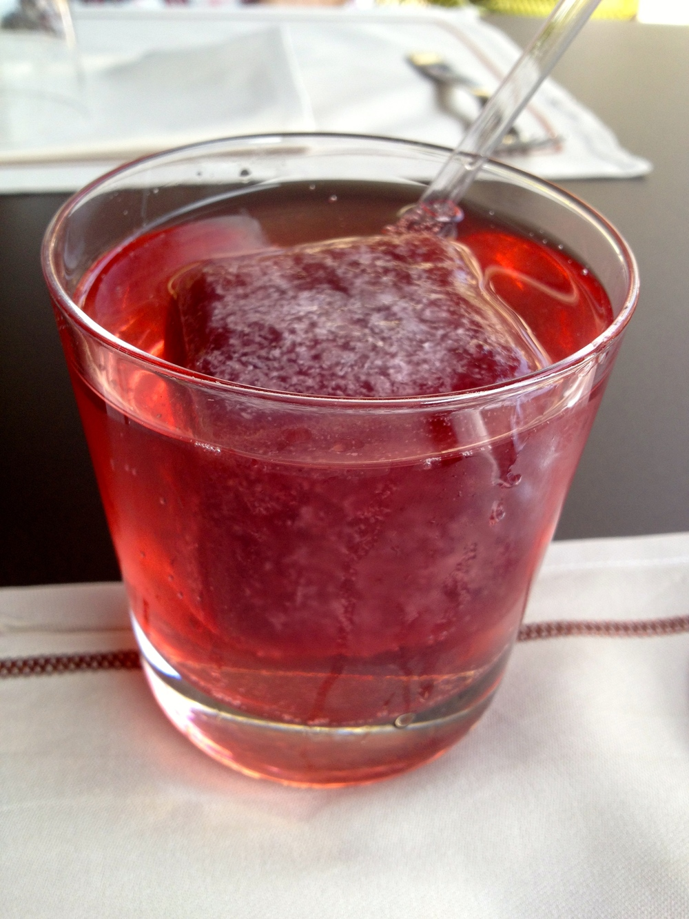 Red Submarine lemonade with elderflower syrup, soda, and a cherry juice ice cube
