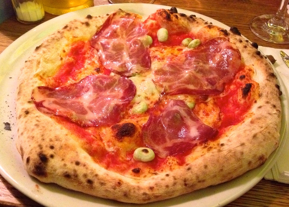 Zampagliene pizza with coppa ham, fava beans, and manchego
