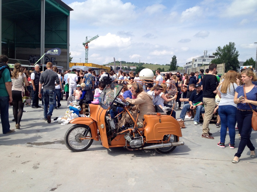 The crowd at 15:00 and this old man playing music in a scooter from his laptop