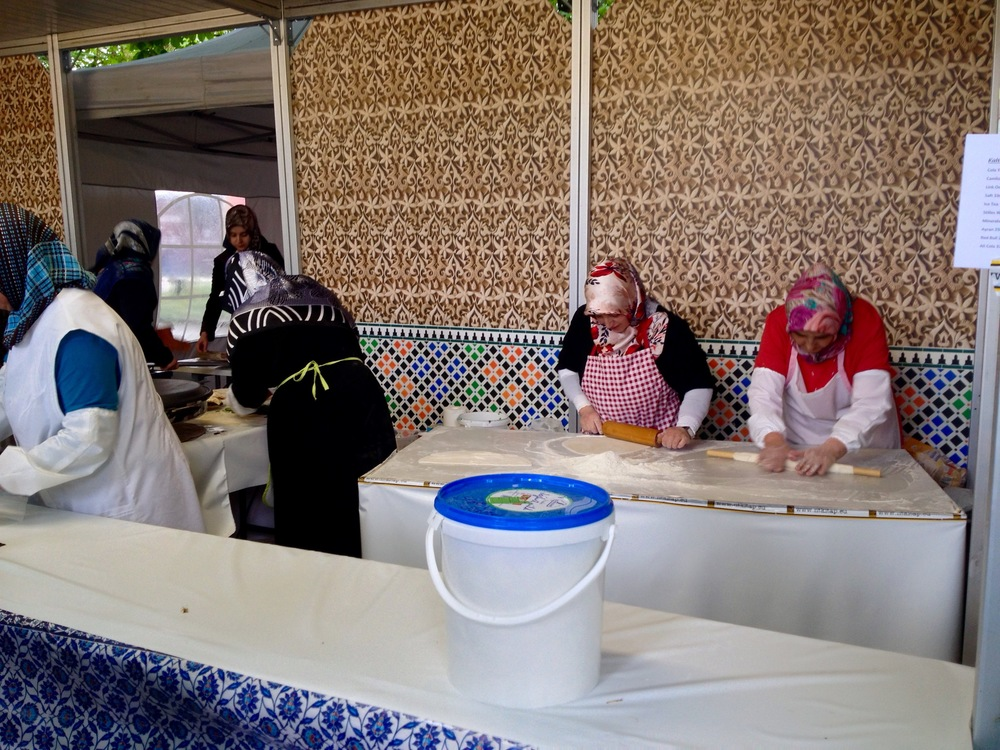 The Turkish women rolling the dough for the  lahmacun