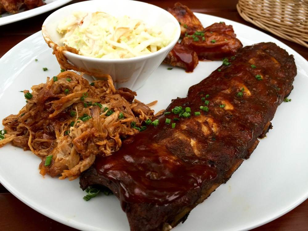 Tasty Teller  with pulled pork, baby back ribs, chicken wings, and cole slaw