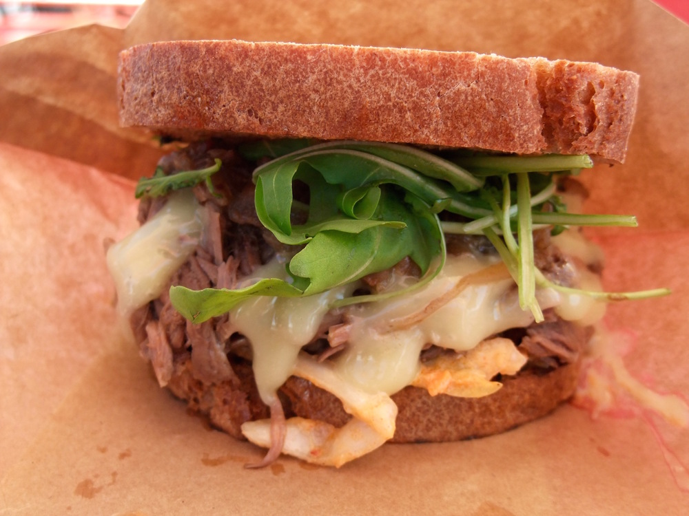 The Fat Frenchman with slow-cooked beef, coleslaw, bacon-onion jam, arugula, and truffle mayo
