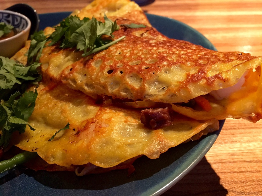 A close-up of the crispy-fried crêpes stuffed with veggies and pork