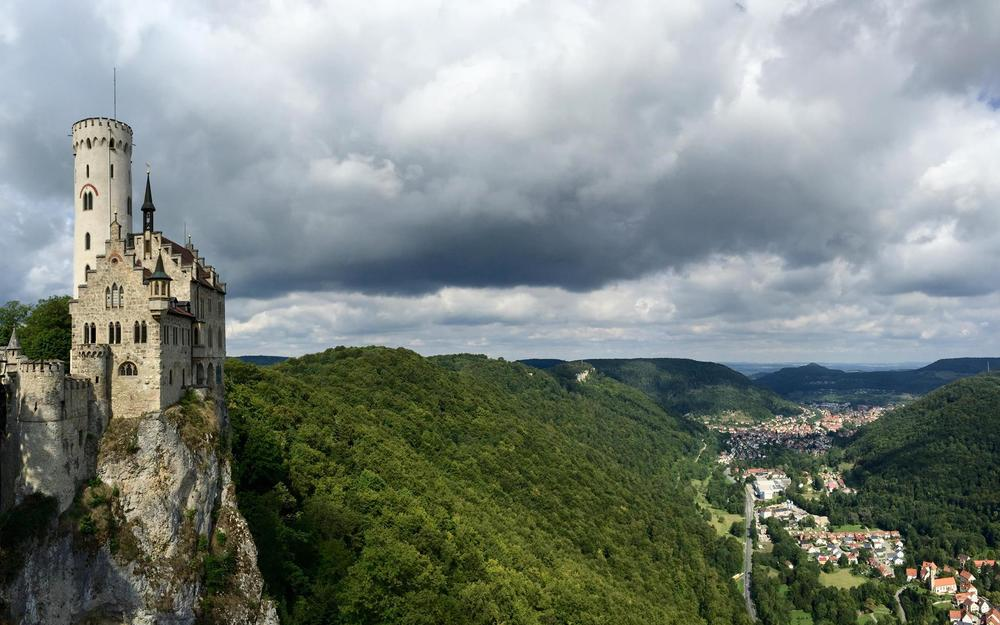 A panoramic shot of the castle and the valley below