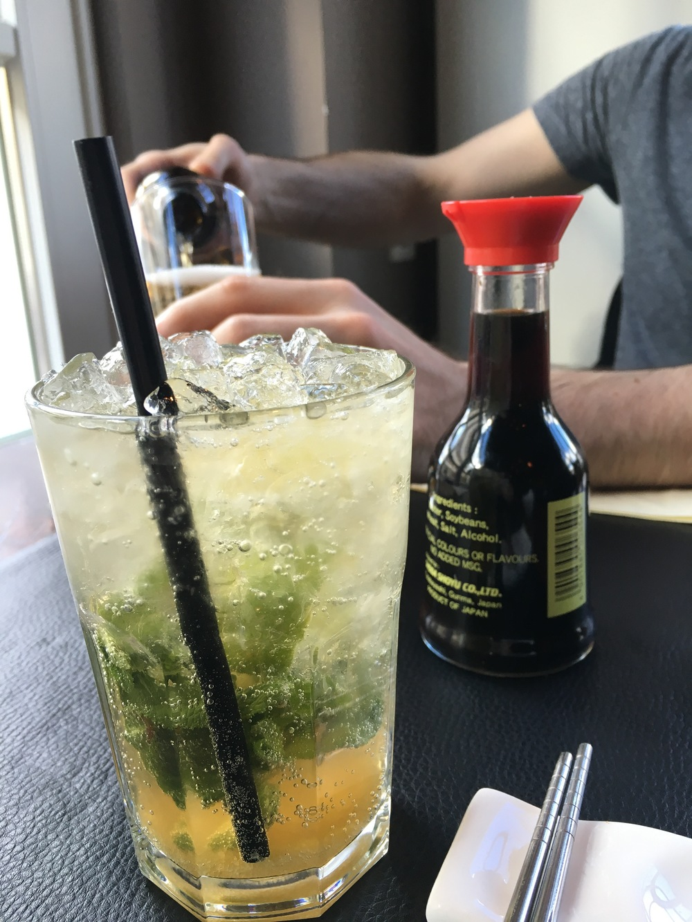 My Asian Cooler cocktail with Matt pouring his Asahi in the background