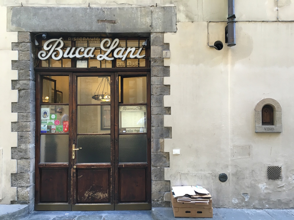 Buca Lapi's wine door at the right