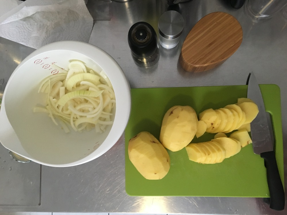 Preparing the potatoes and onion