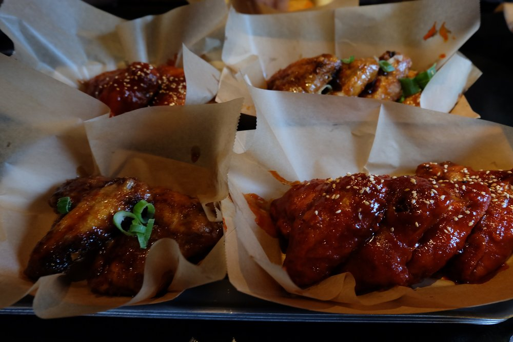 Korean hot and  tebasake soy garlic wings at Beer and Buns