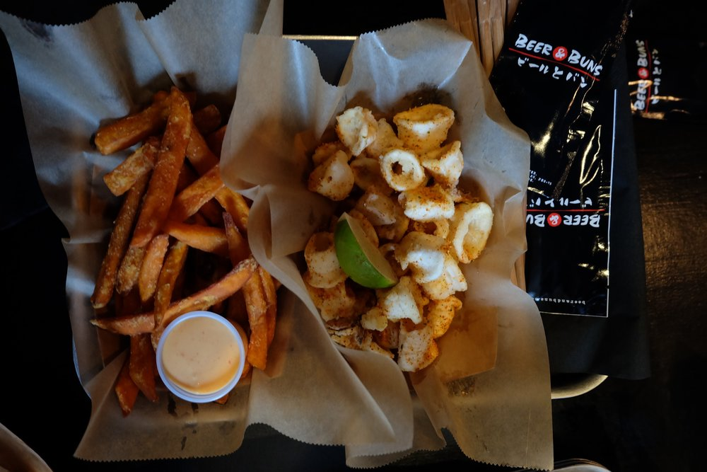 Sweet potato fries and salt and pepper chili squid at Beer and Buns