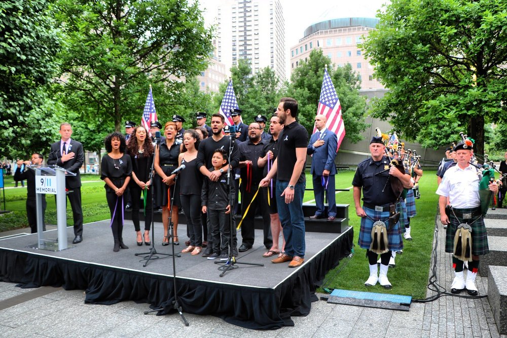 Eric Ulloa & members of the  On Your Feet!  company sing the National Anthem at the Pulse memorial
