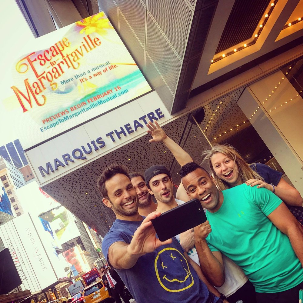 Justin Mortelliti (left, with company members from  Escape to Margaritaville )