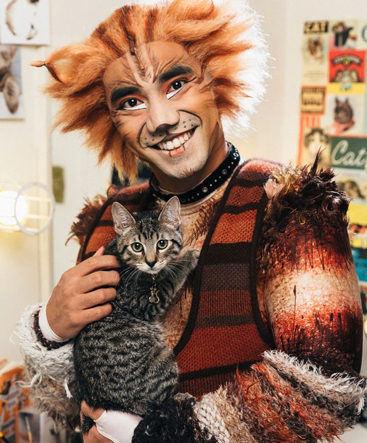 Aaron Albano backstage at  Cats.  With a real cat.